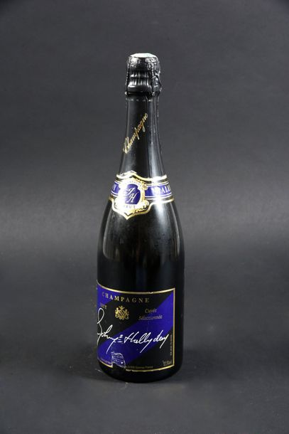 1983. Bouteille de champagne «Johnny Hallyday» Col et muselet intacts. Offert po…