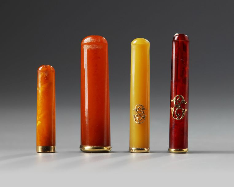 A lot of four Ottoman pipes A lot of four Ottoman pipes of amber and et with gilt…