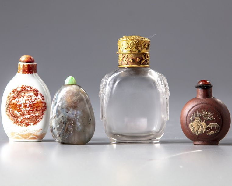 Four Chinese snuff bottles The group comprises a rock crystal snuff bottle decorated…