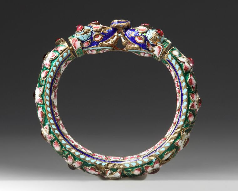 An Indian mughal enamel bangle The bangle is worked in silver, with fine enamelling…