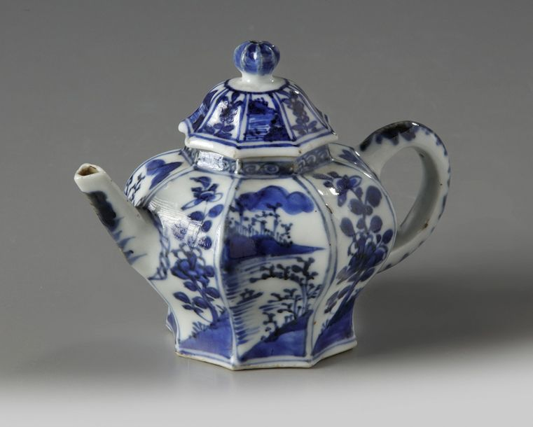 A Chinese blue and white moulded octagonal teapot and cover The straight spout and…