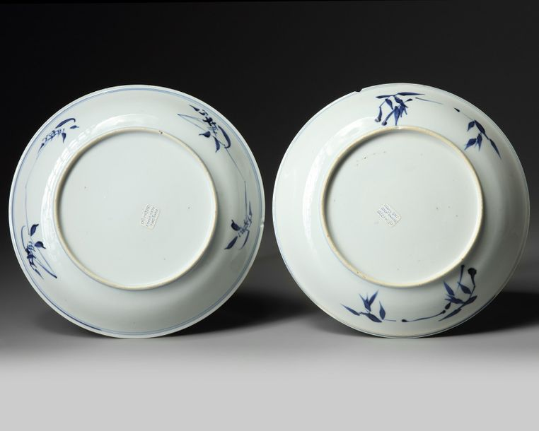 A pair of Chinese gilt-decorated blue and white 'pheasant and peony' dishes Each…