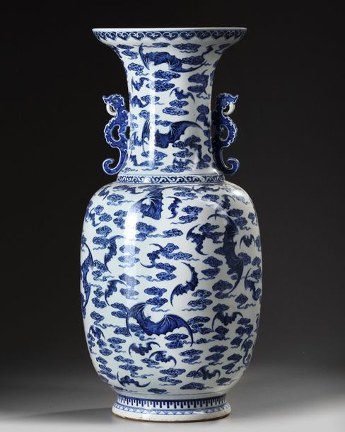 A Chinese blue and white 'Fu-bats' vase A Chinese porcelain vase flanked y two dragon…
