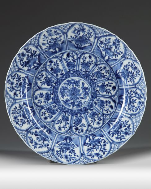 A Chinese blue and white 'floral' dish The dish is decorated to the centre with a…