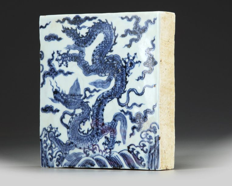 A Chinese blue and white square 'dragon' tile A Chinese square porcelain tile, decorated…