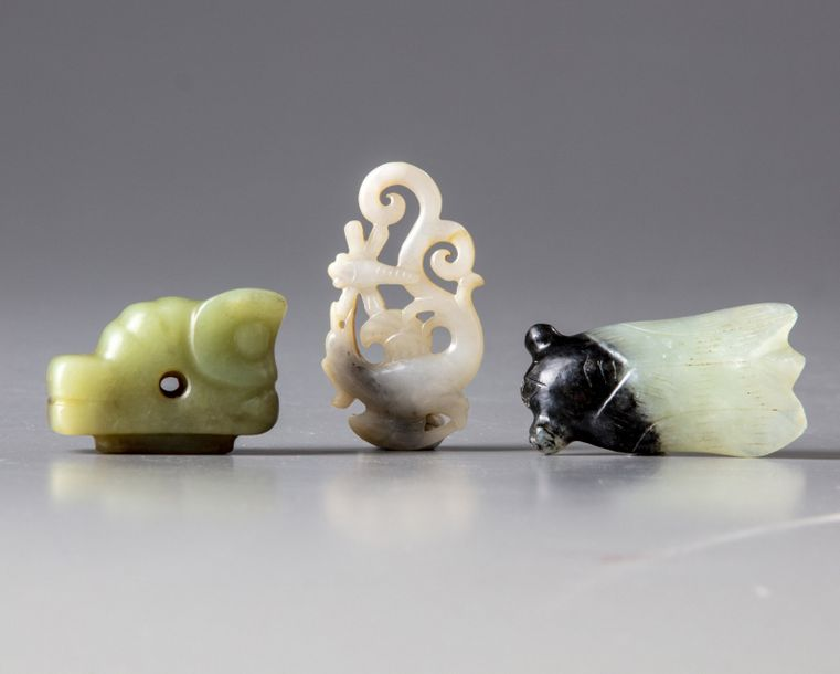 Three Chinese jade carvings The group comprises a celadon and russet jade beast,…