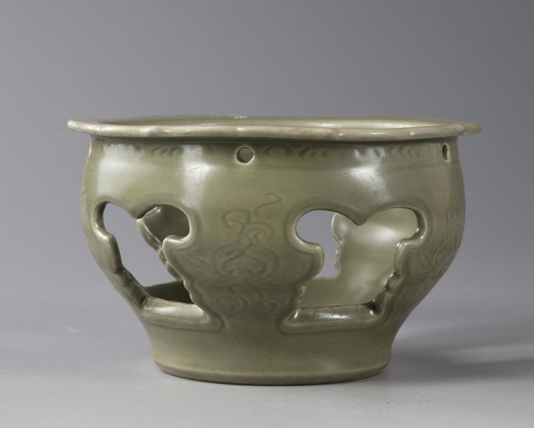 A Chinese celadon glazed base With an openwork design.    Origin: China    Period:…
