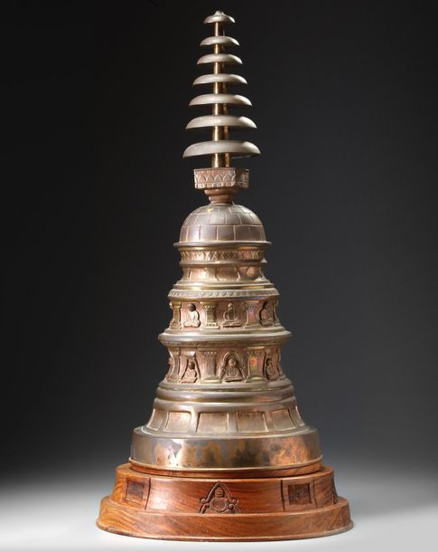A Indian copper stupa With stand 80.00 cm high.    Origin: India    Sizes: 71.00…