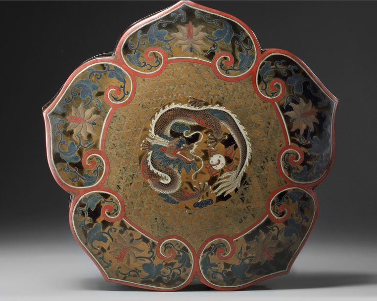 A Chinese lacquer 'dragon' box and cover A Chinese lacquer box with ruyi shaped sides,…