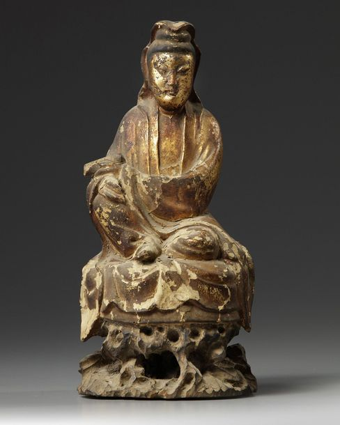 A Chinese gilt-lacquered wood Guanyin The Goddess of Mercy is carved with a serene…