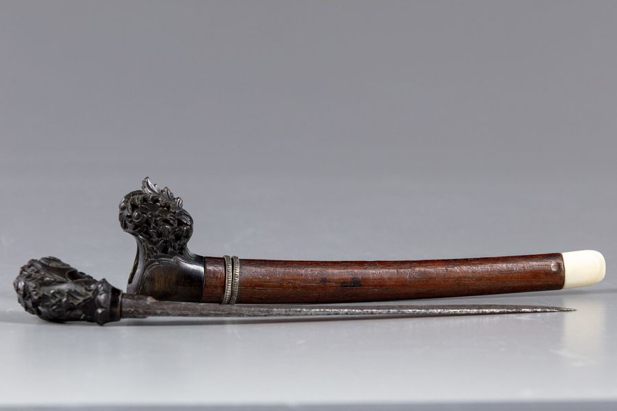 A Burmese dagger Dha The single-edged watered steel blade of tapering form with bird…