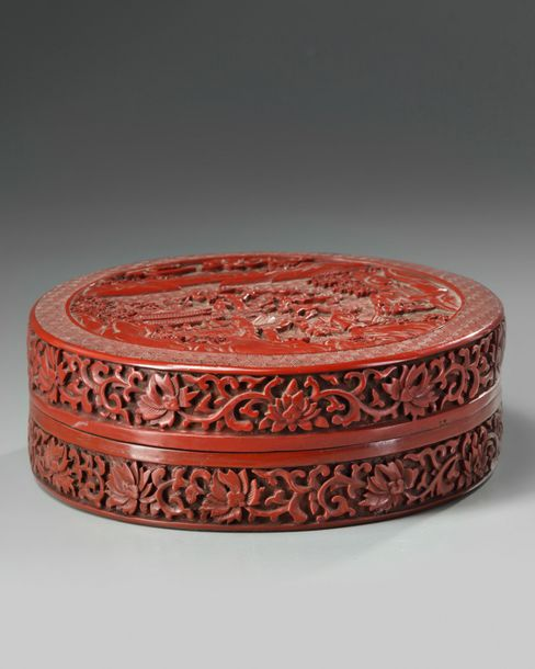 A Chinese lacquer box with garden scene A carved red lacquer box and cover of rounded…