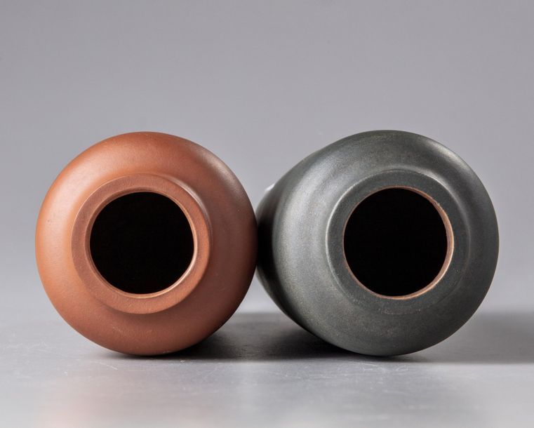 A pair of Chinese Yixing vases The group comprises a red clay vase and a green clay…