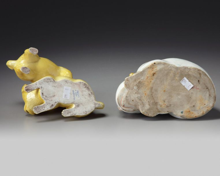 Two Japanese figures of animals A Kutani porcelain sleeping cat ,cast with feet tucked…