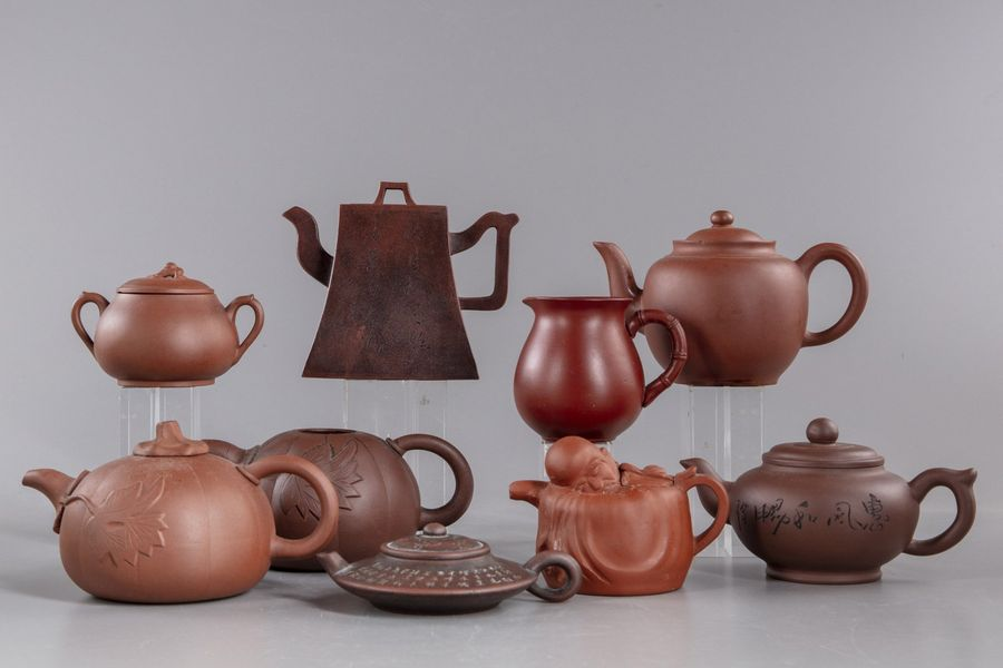 A lot of nine Yixing items A lot of nine Yixing items, with six teapot, a rectangular…