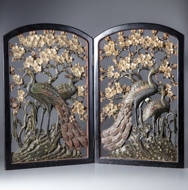 Two Chinese panels of carved peacocks Two Chinese wooden panels each depicting two…
