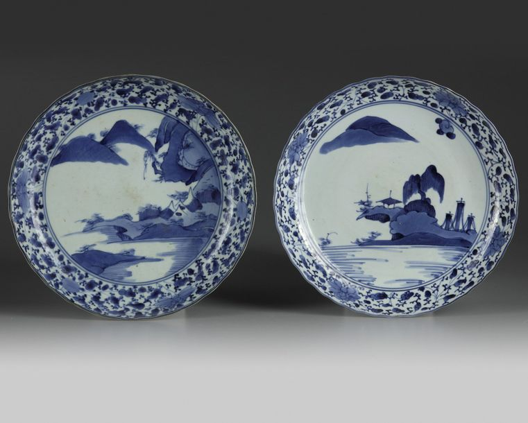 A matched pair of Japanese arita 'landscape' dishes Both dishes on footring, undulating…