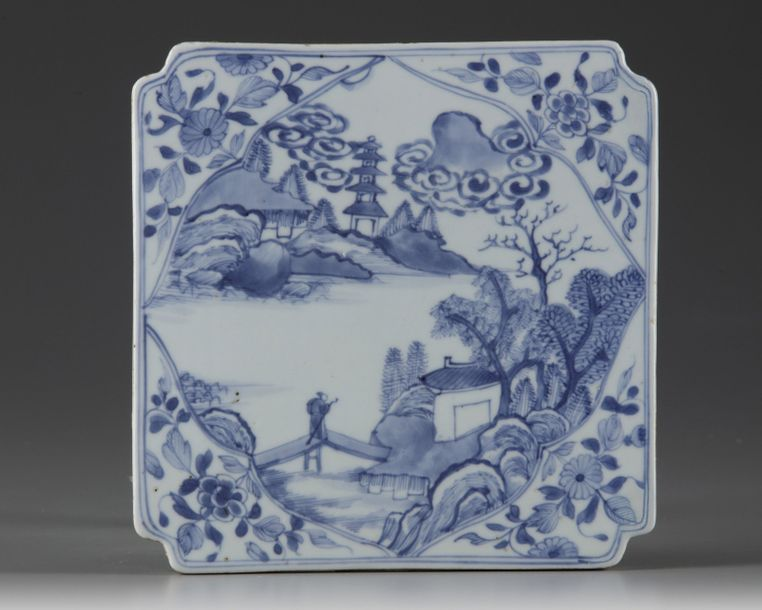 A Chinese blue and white square tile The tile is modelled with canted corners and…