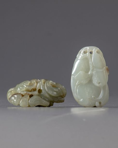 Two Chinese jade carvings Comprising a white jade gourds group and a celadon jade…