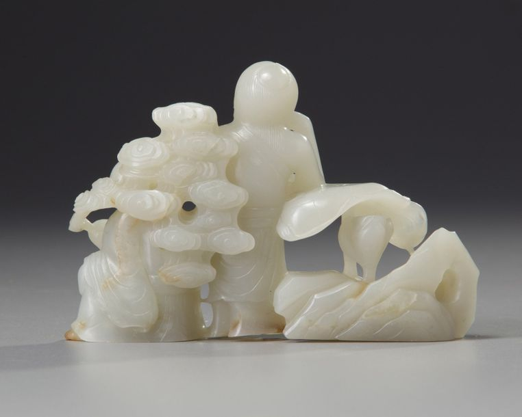 A Chinese white jade carving of the Laughing Twins The piece is carved and pierced…