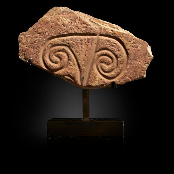 Antiquities: A carved petroglyph, Morocco, Neolithic, on bronze stand, 23cm high…