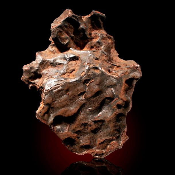 A Sikhote Alin iron meteorite, 21cm by 16cm, 7.9kg, This Iron meteorite fell in…