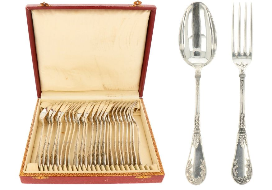 (24) silver cutlery set. With molded decorations and filled handles, blade metal.…