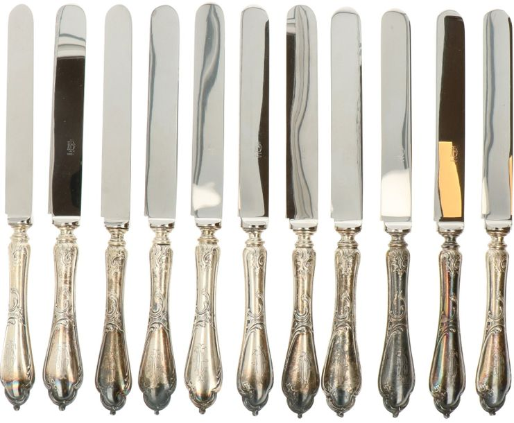(11) knife set BWG. Decorated with baroque decorations, filled handles. 20th century…