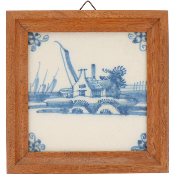 A lot of four earthenware tiles in wooden frame. Delft, 19th century.