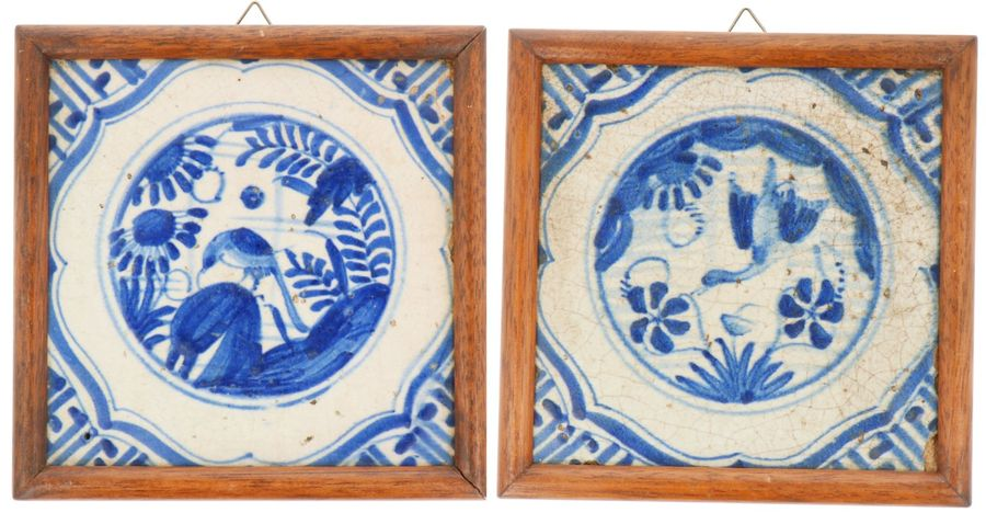 A lot of two earthenware tiles in wooden frames. Delft, 18th century.