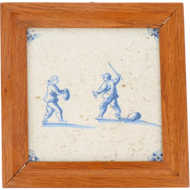 A lot of three earthenware tiles in wooden frames. Delft, 18th century.