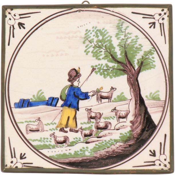 A lot of three earthenware tiles with polychrome decor in copper frames. Delft, 18th…