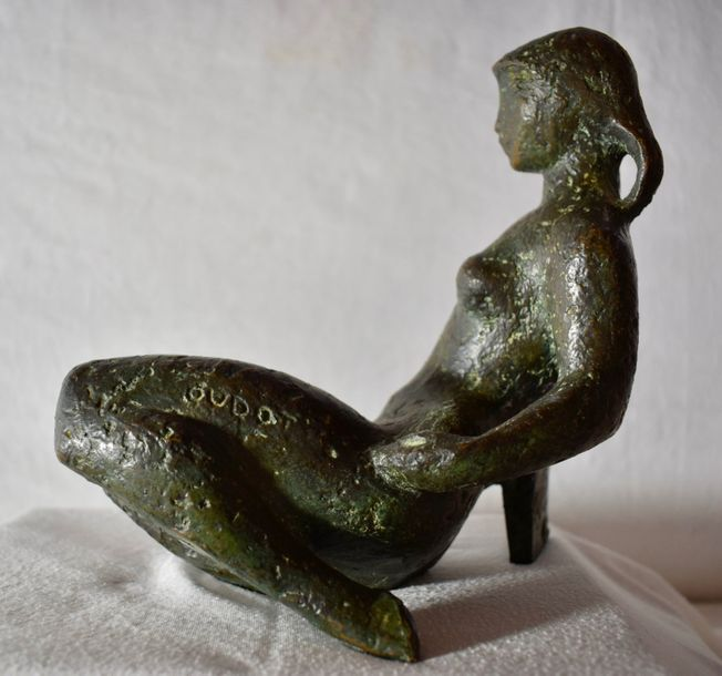 George Oudot (French, 1928-2004) Reclining nude. Bronze sculpture with green patina…