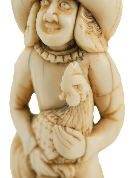 Ivory Netsuke Dutchman. Japan. Late 18th century.  The figure is depicted with a…