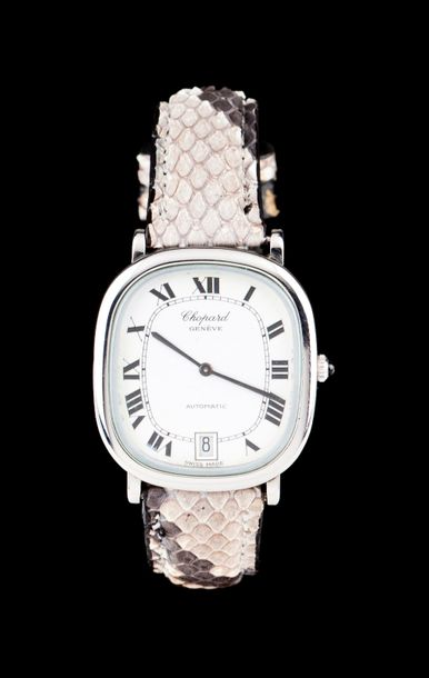 Chopard automatic mechanic movement with date at 6. Steel case and snake skin strap.…
