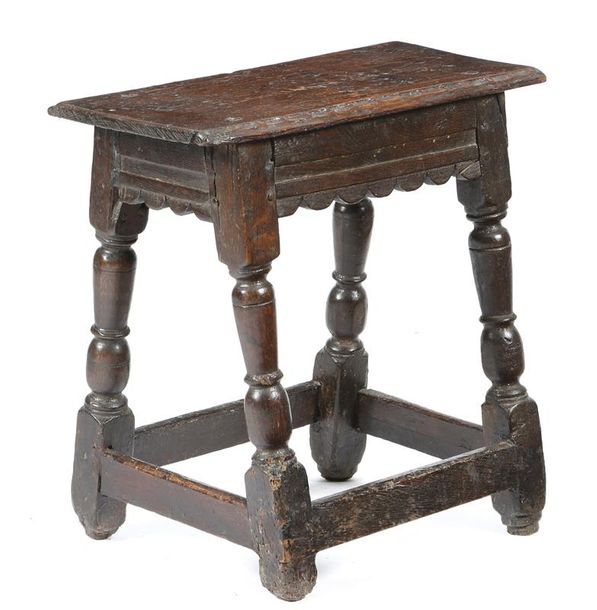 A mid-17th century oak joint stool, the top with thumbnail carved edges, above a…