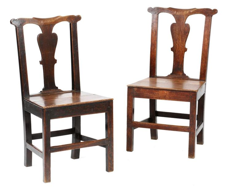 A pair of George II country oak side chairs, each with a vase shaped splat. above…