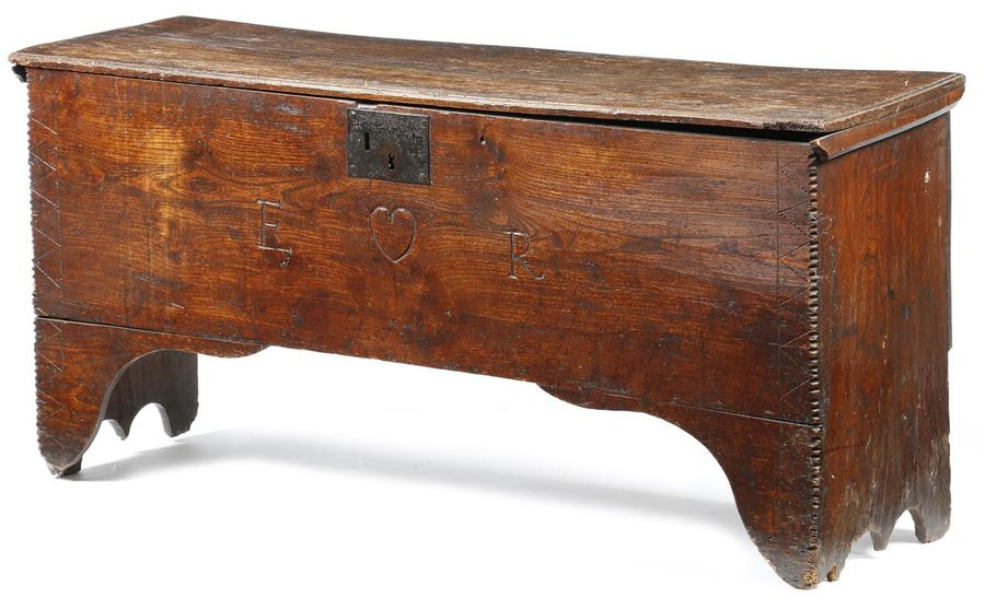 An elm coffer, the hinged top with a moulded edge, revealing a lidded till, the…