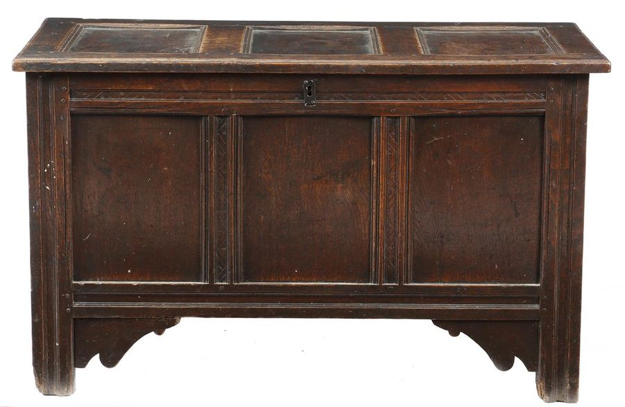 An early 18th century oak triple panelled coffer, the hinged lid revealing a vacant…