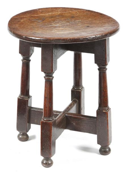 A rare small Charles II oak stool, the circular top on a cruciform base, with block…