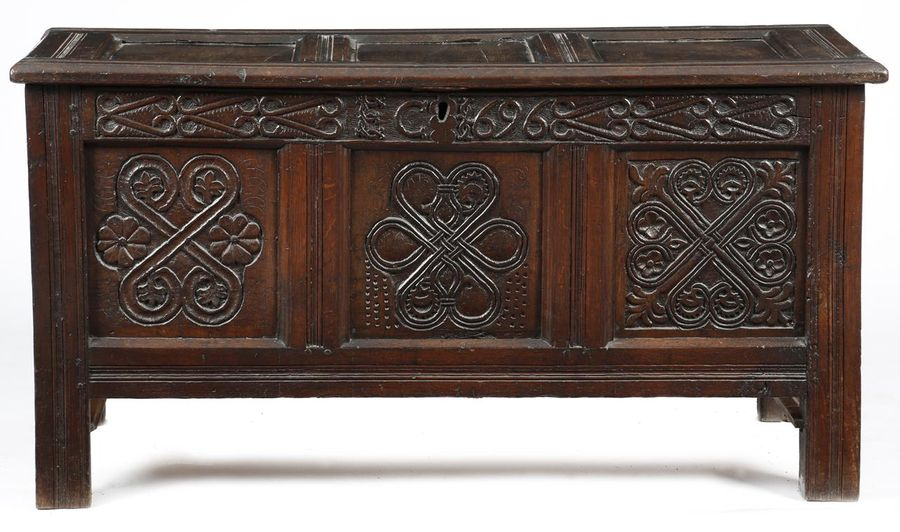 A late 17th century oak triple panelled coffer, the hinged lid revealing a vacant…