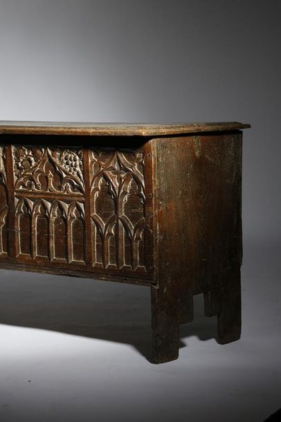 An oak boarded chest, the hinged lid with a raised central panel revealing an interior…