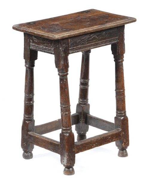 A 17th century and later oak joint stool, the associated top above a moulded frieze,…