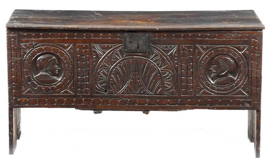 A 17th century oak coffer, the hinged lid with moulded and crimped edges, the front…