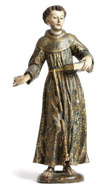 A 17th century carved wood and polychrome decorated figure of Saint Francis of Assisi,…