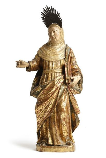An 18th century Spanish carved wood and polychrome painted figure of Saint Teresa,…