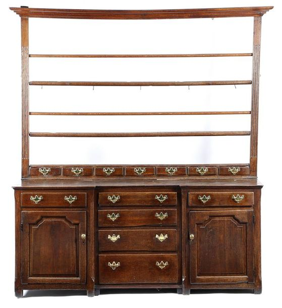 A George III oak dresser, the raised plate rack with two turned poles and fluted…