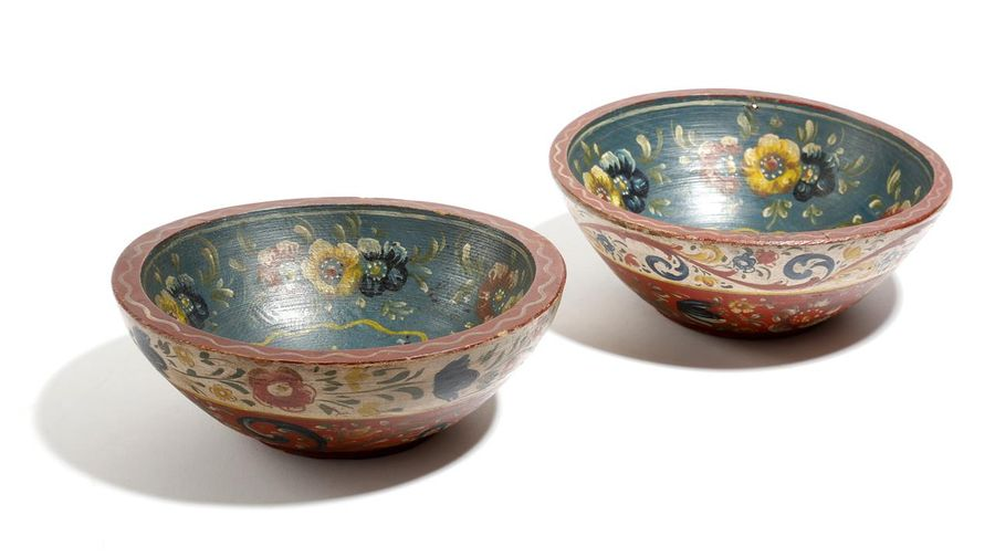 A pair of Norwegian folk art painted wood bowls, decorated with bands of flowers,…
