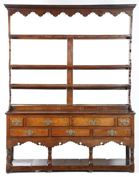 A George III Welsh oak dresser, the raised plate rack with a dentil cornice, with…