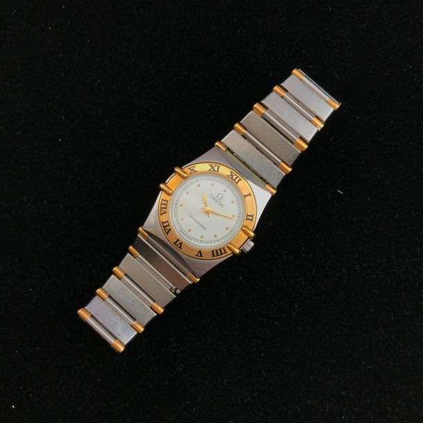 """A stainless steel and yellow gold plated lady's wristwatch by Omega """"Constellation"""".…"""